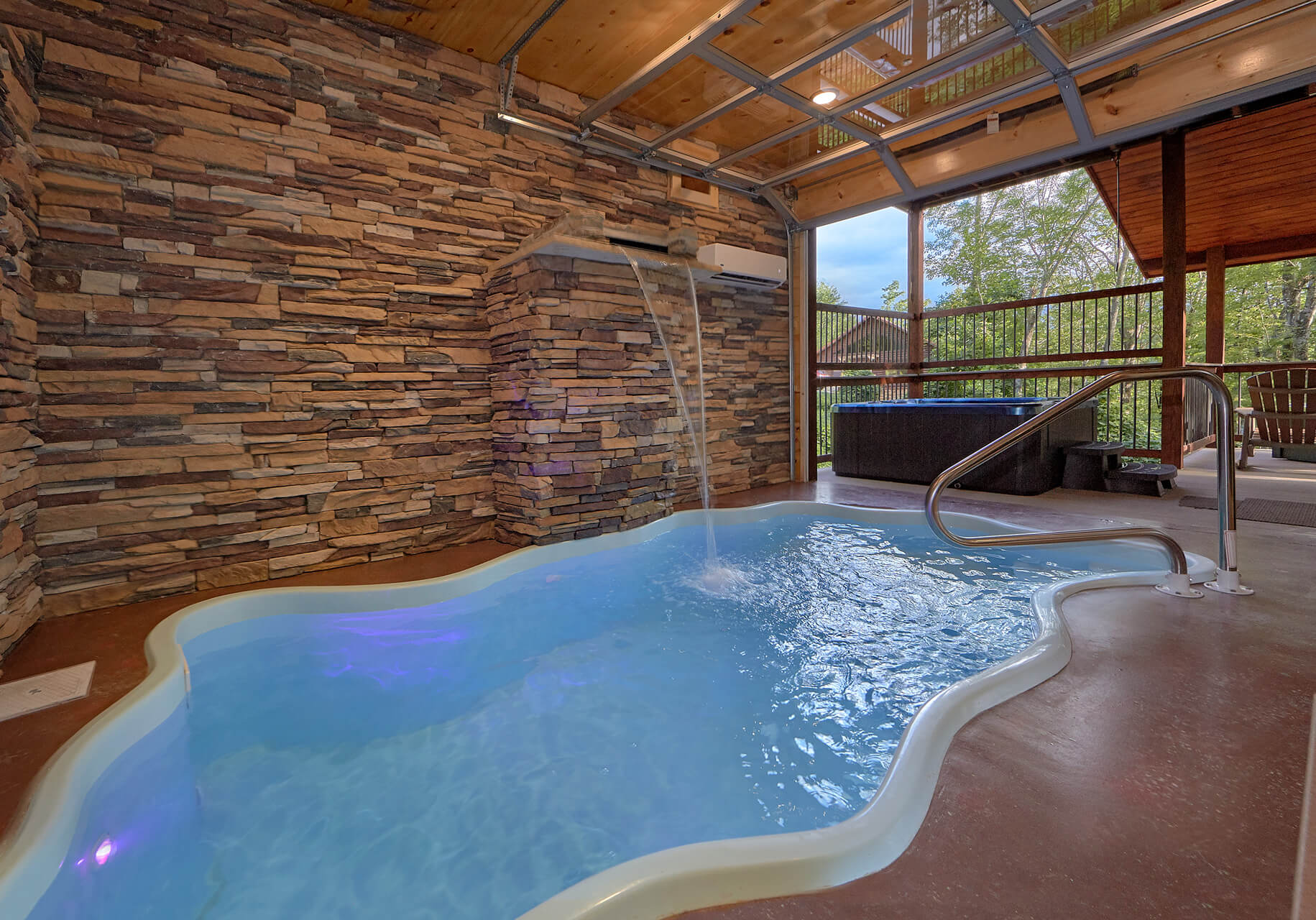 pool with located lodge inspirational in majestic bedroom view cabins collection and of cabin theater gatlinburg awesome indoor room