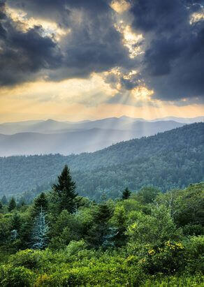 Sunbeams Light Rays Over Southern Appalachian Blue Ridge Mountains at dramatic summer sunset